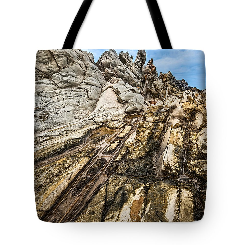 Dragons Teeth Tote Bag featuring the photograph Dramatic Lava Rock Formation Called The Dragon's Teeth In Maui. by Jamie Pham