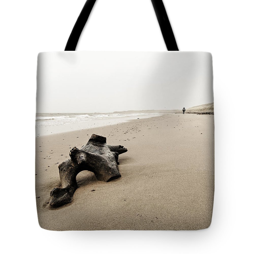 Sea Tote Bag featuring the photograph Driftwood On The Beach by Dutourdumonde Photography