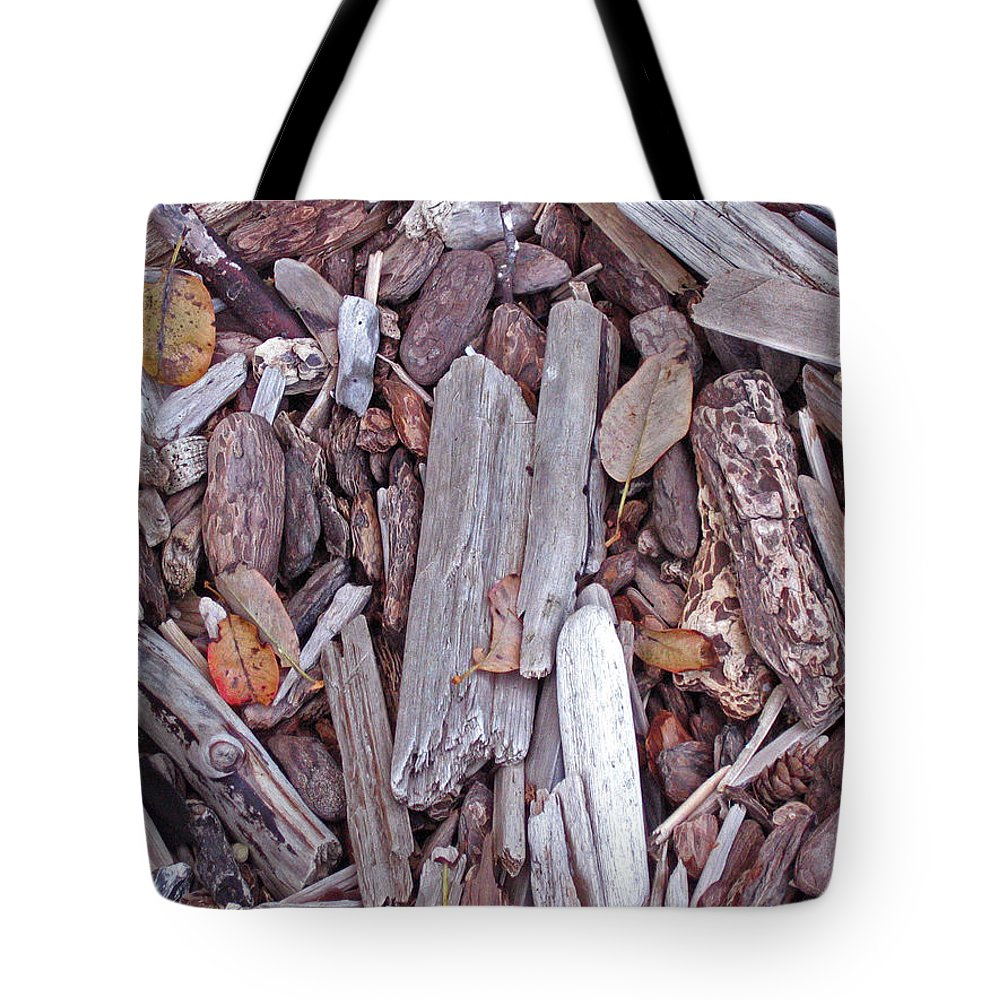 Beach Tote Bag featuring the photograph Driftwood Patterns by Abigail Ellison