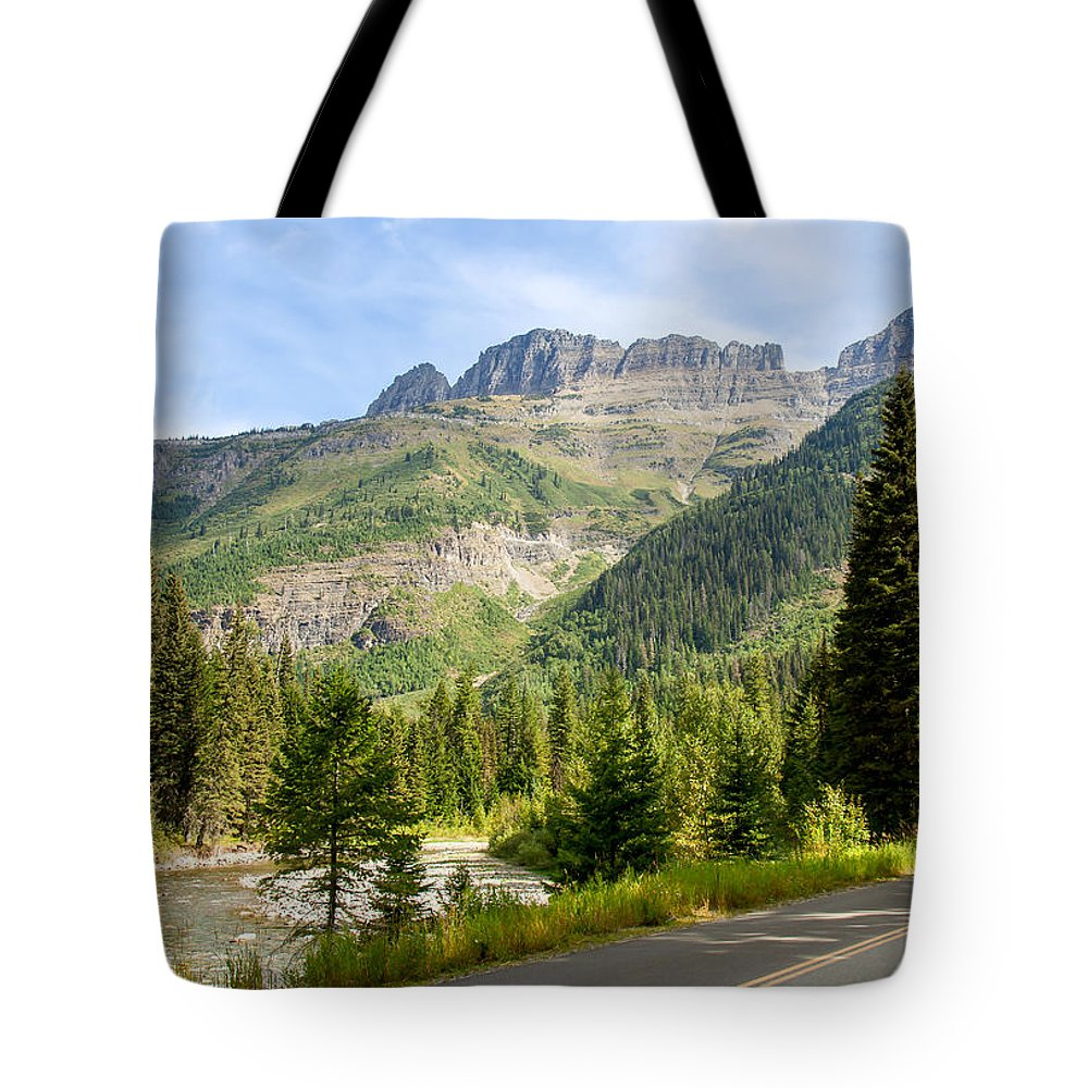 Landscape Tote Bag featuring the photograph Driving Through Glacier National Park by John M Bailey
