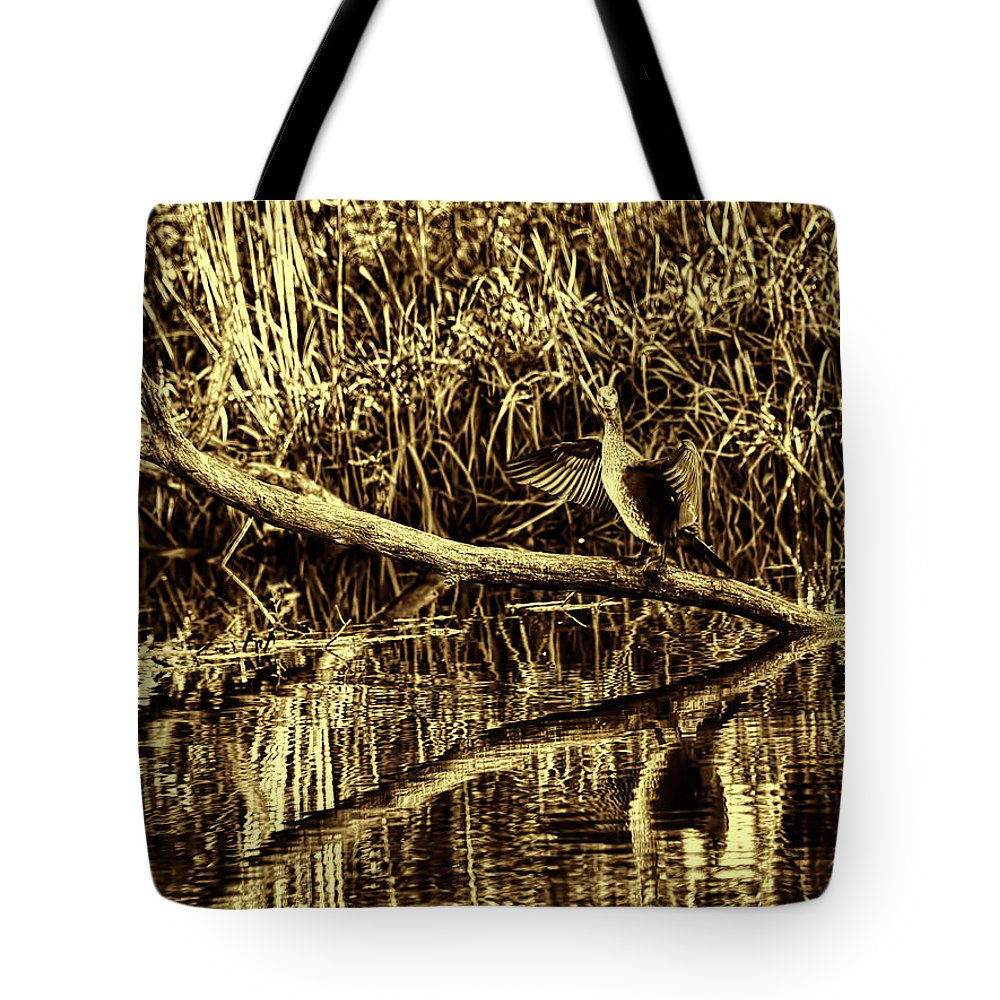 Black And White Tote Bag featuring the photograph drying cormorant BW- Black bird sitting on log over water by Leif Sohlman