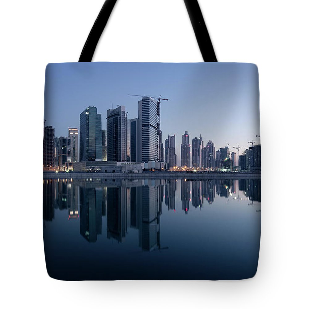 Tranquility Tote Bag featuring the photograph Dubai Business Bay Skyline With by Spreephoto.de