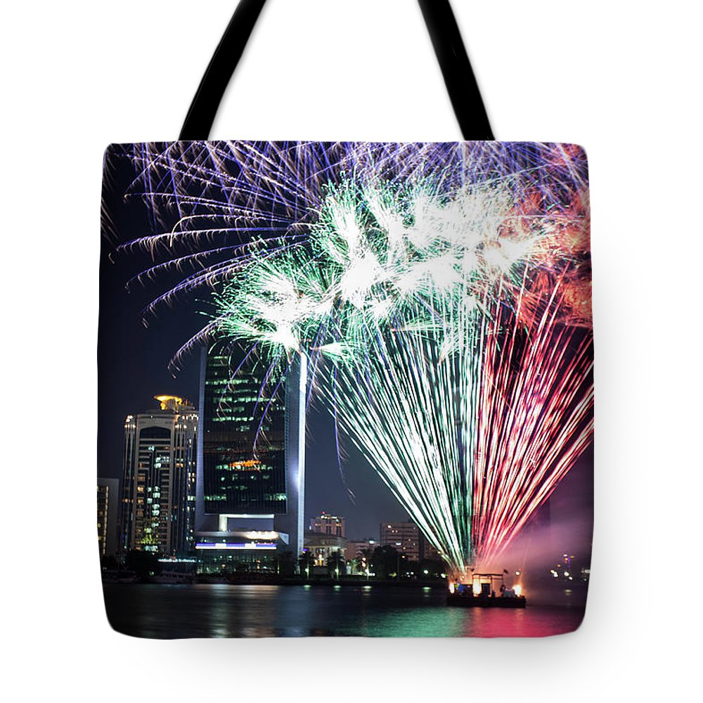 Firework Display Tote Bag featuring the photograph Dubai Creek Fireworks by Shahin Olakara Photography