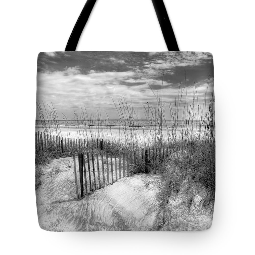 Clouds Tote Bag featuring the photograph Dune Fences by Debra and Dave Vanderlaan