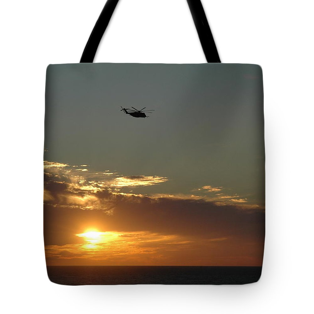 Evening Tote Bag featuring the photograph Dusk Fly Over by Roe Rader