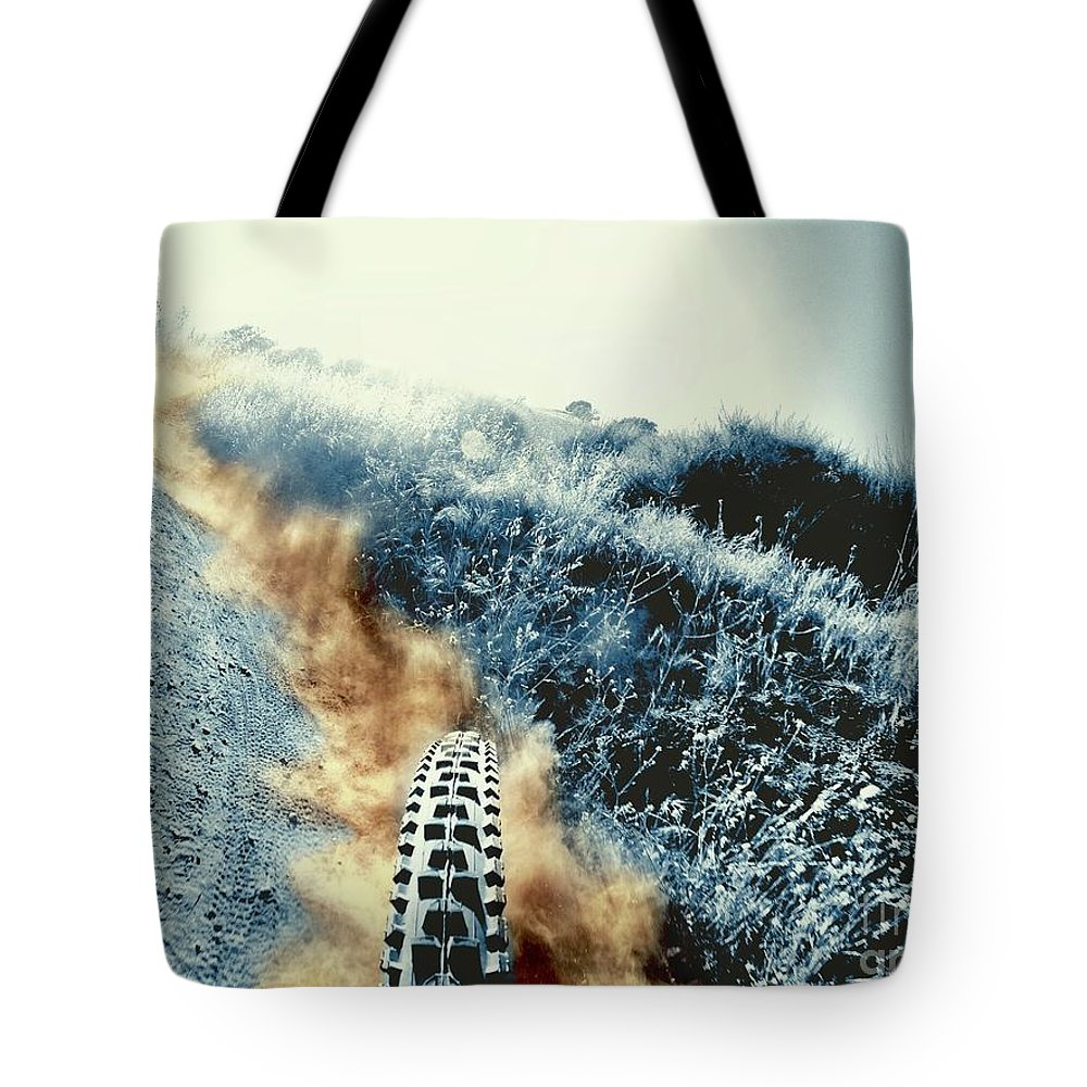 Mountain Bike Tote Bag featuring the photograph Dust Trails by Chris Phillips