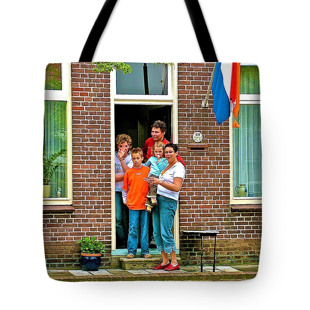 Dutch Family On Orange Day In Enkhuizen Tote Bag featuring the photograph Dutch Family On Orange Day In Enkhuizen-netherlands by Ruth Hager