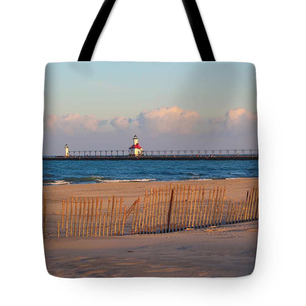 St. Joseph Michigan Tote Bag featuring the photograph Early Morning Beach And Lighthouse by Harold Hopkins