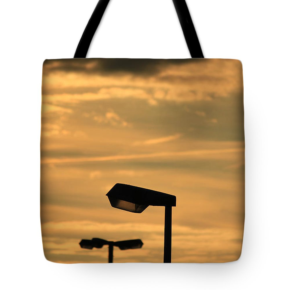 Sunset Tote Bag featuring the photograph Early Sunset by Four Hands Art