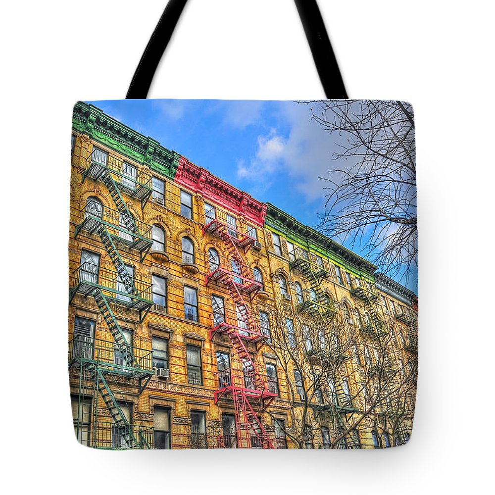 The Village Tote Bag featuring the photograph East Village Buildings On East Fourth Street And Bowery by Randy Aveille