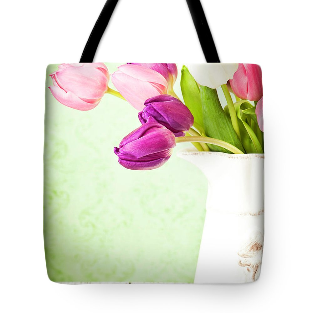 Mother's Day Tote Bag featuring the photograph Easter Tulips And Copy Space by Catlane