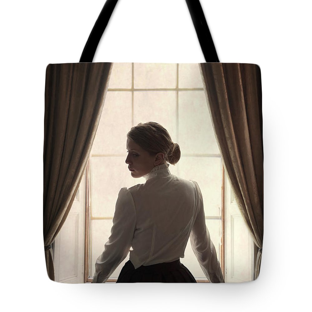 Edwardian Tote Bag featuring the photograph Edwardian Woman At The Window by Lee Avison