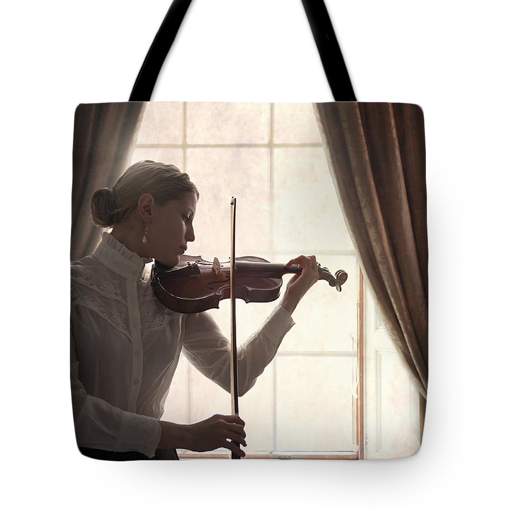 Edwardian Tote Bag featuring the photograph Edwardian Woman Playing Violin At The Window by Lee Avison