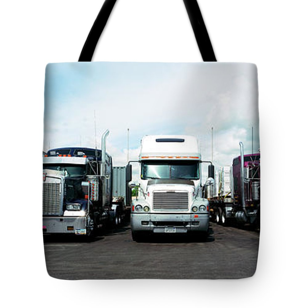 Photography Tote Bag featuring the photograph Eighteen Wheeler Vehicles On The Road by Panoramic Images