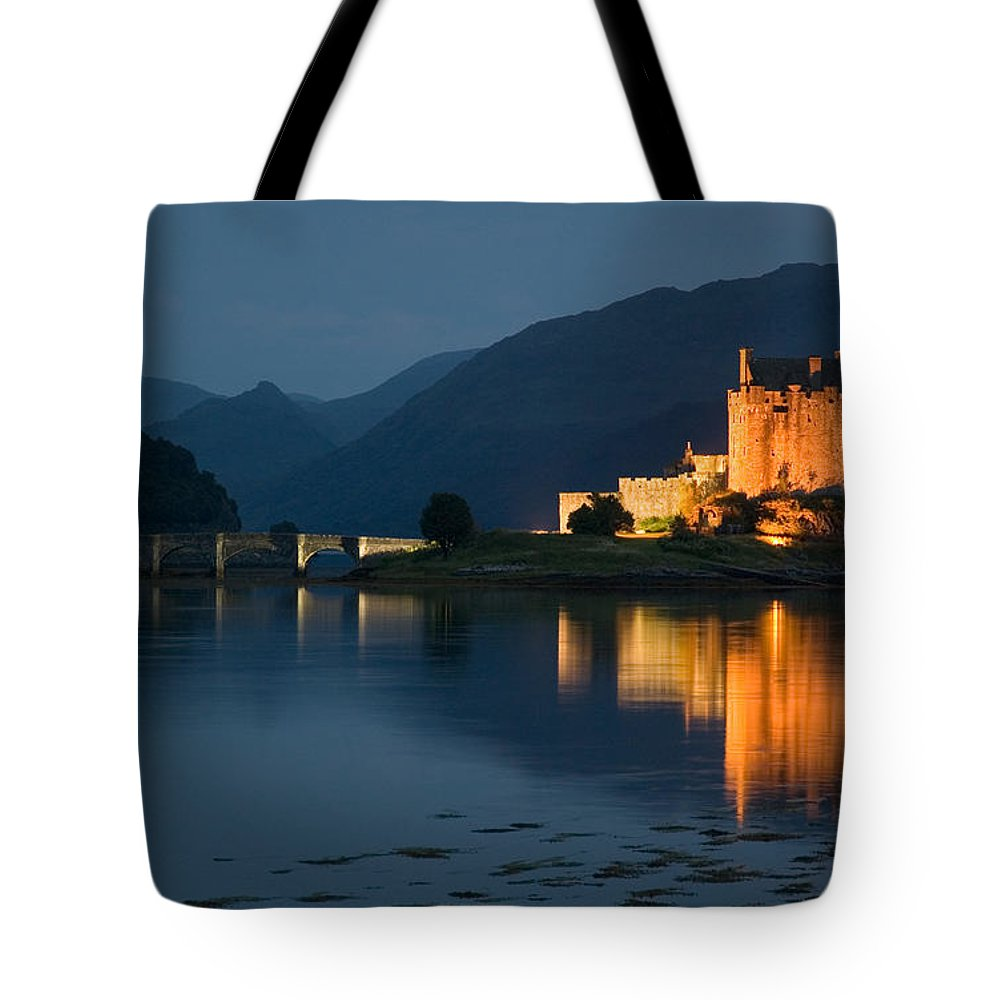 Eilean Donan Castle Tote Bag featuring the photograph Eilean Donan Castle At Night by Jeremy Voisey