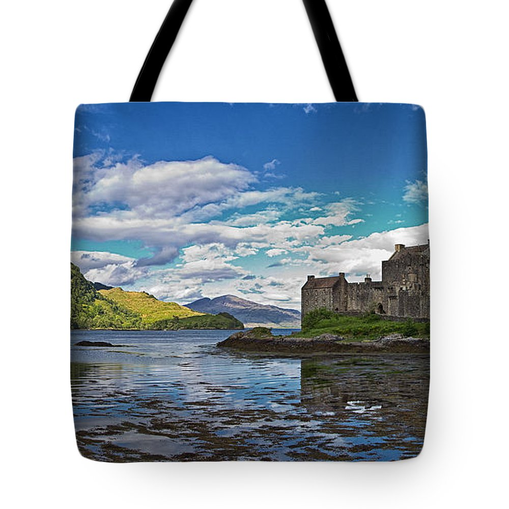 Eilean Tote Bag featuring the photograph Eilean Donan Castle by David Pringle