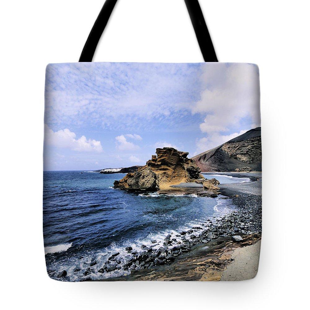 Beach Tote Bag featuring the photograph El Golfo Beach On Lanzarote by Karol Kozlowski