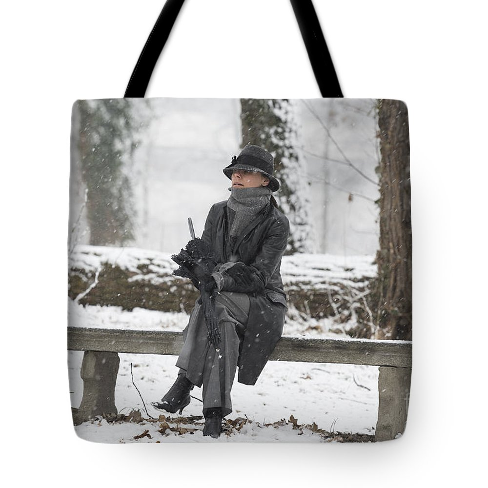 Woman Tote Bag featuring the photograph Elegant Woman Sitting On A Bench by Mats Silvan