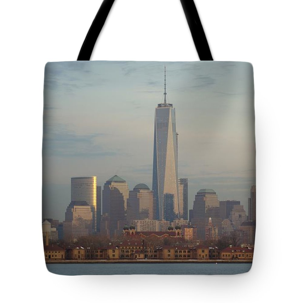 Freedom Tote Bag featuring the photograph Ellis Island And The Freedom Tower by John Wall