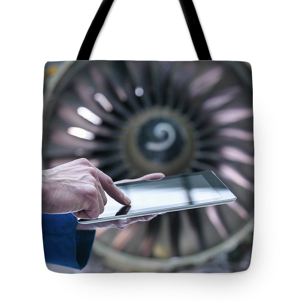 Focus Tote Bag featuring the photograph Engineer Using Digital Tablet In Front by Monty Rakusen