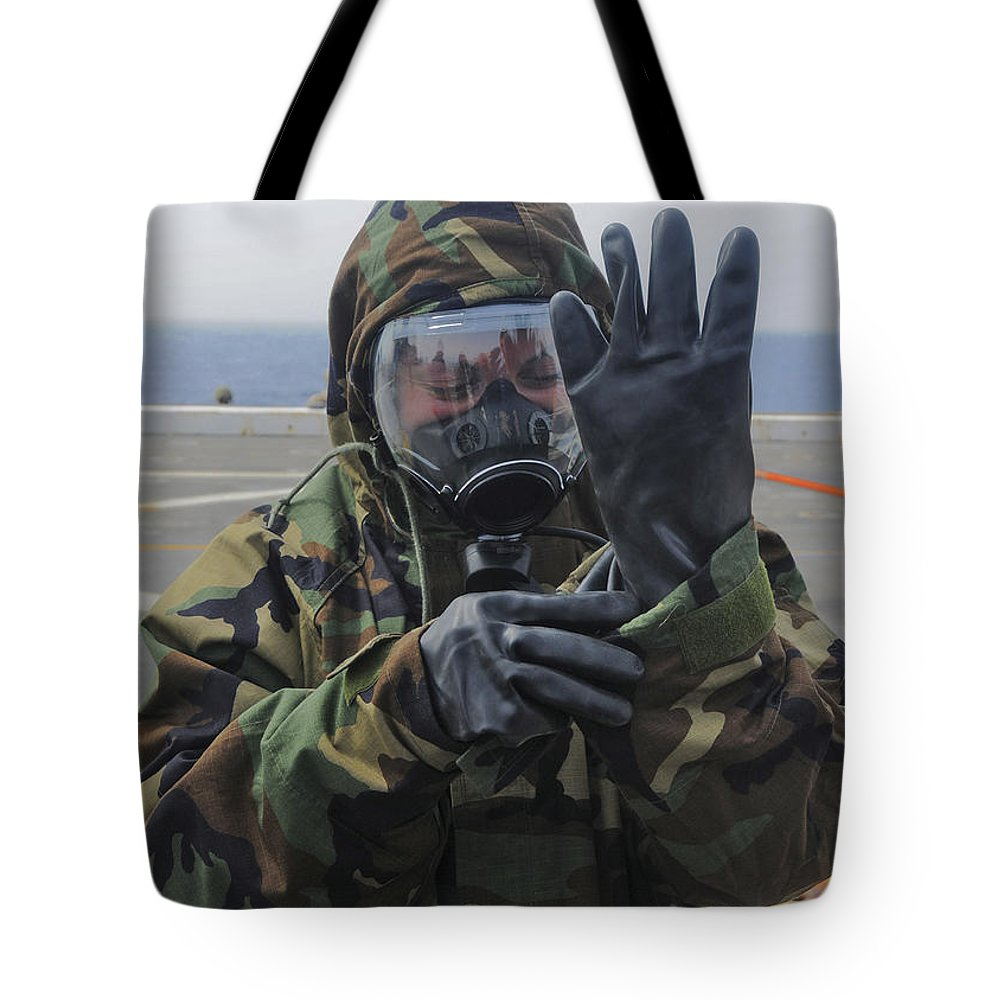 Obscured Face Tote Bag featuring the photograph Ensign Dons A Lightweight Integrated by Stocktrek Images