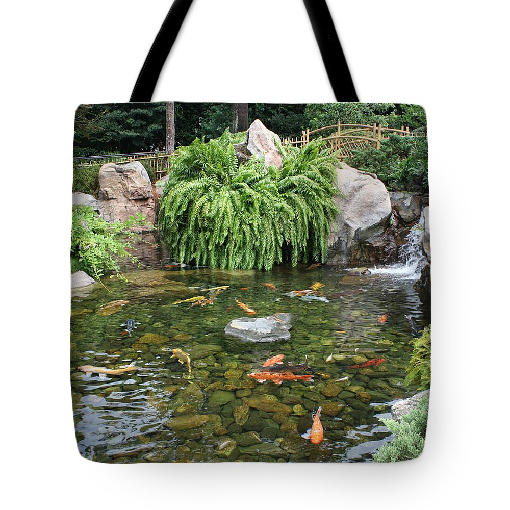 Disney World Tote Bag featuring the photograph Epcot Koi's by David Nicholls