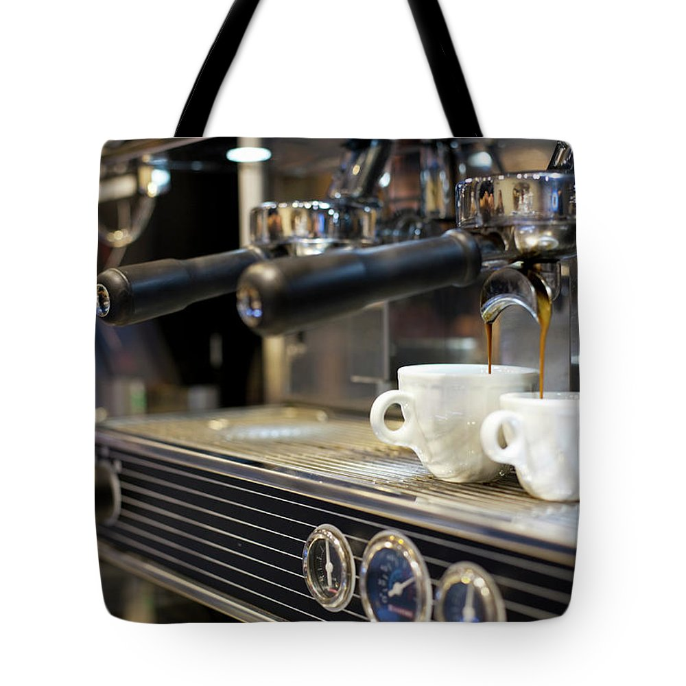 Making Tote Bag featuring the photograph Espresso Machine Pouring Coffee Into by Kathrin Ziegler