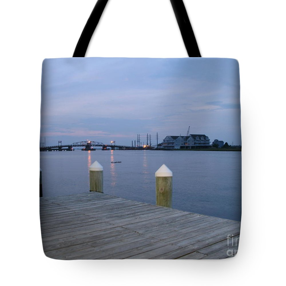 Evening Light Tote Bag featuring the photograph Evening Light At Chincoteague Sound by Christiane Schulze Art And Photography