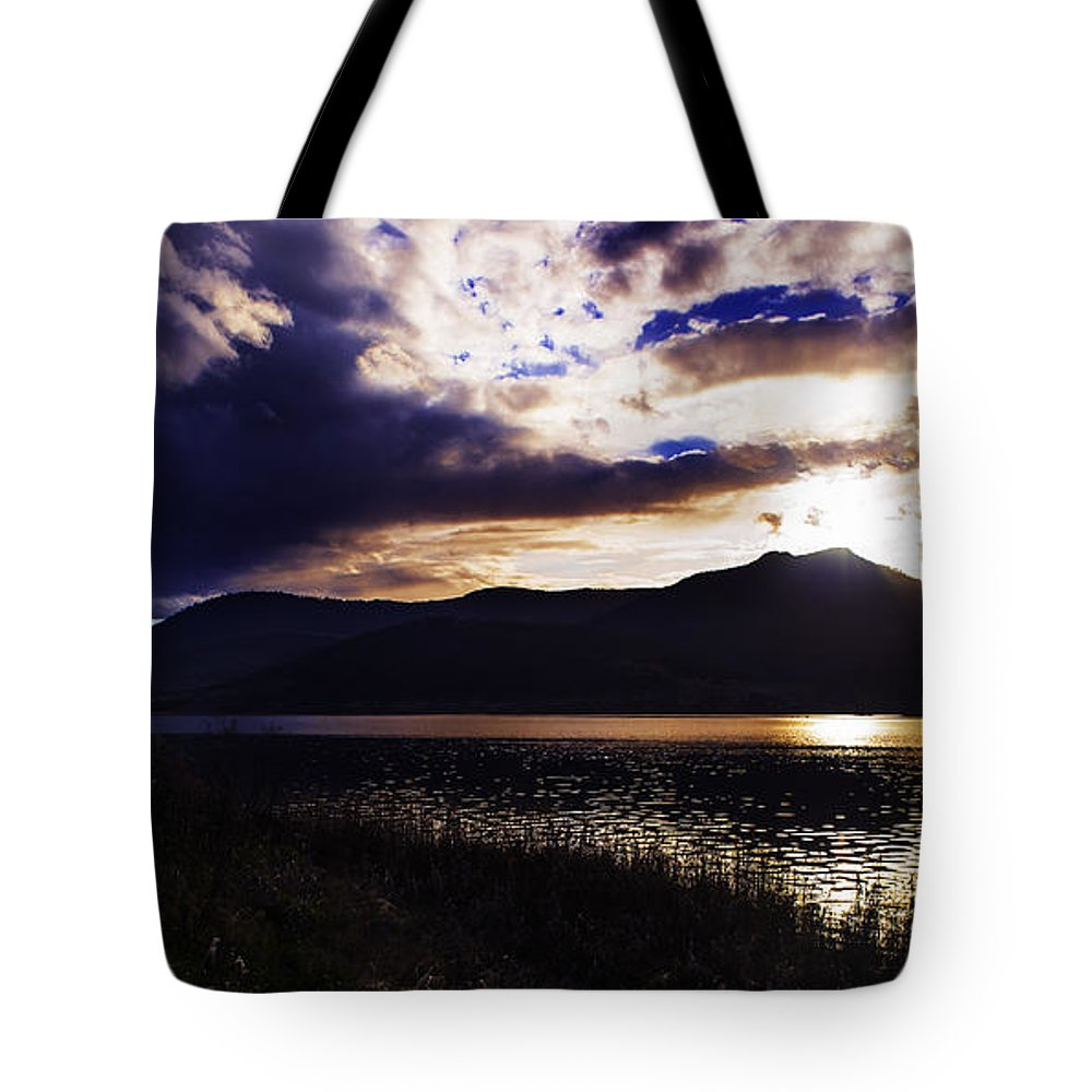 Sunset Tote Bag featuring the photograph Evening Light by Phill Petrovic