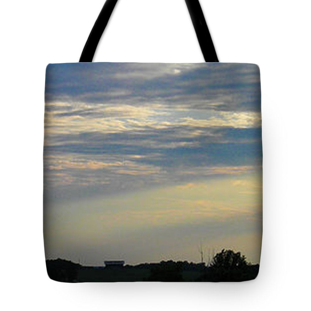 Sunset Tote Bag featuring the photograph Evening Rays by Nick Kirby