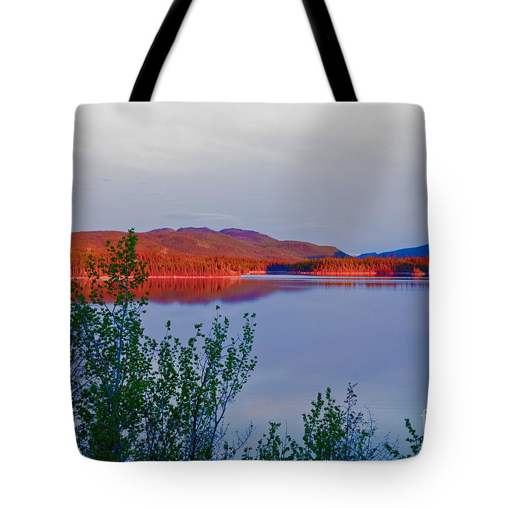 Adventure Tote Bag featuring the photograph Evening Sun Glow On Calm Twin Lakes Yukon Canada by Stephan Pietzko