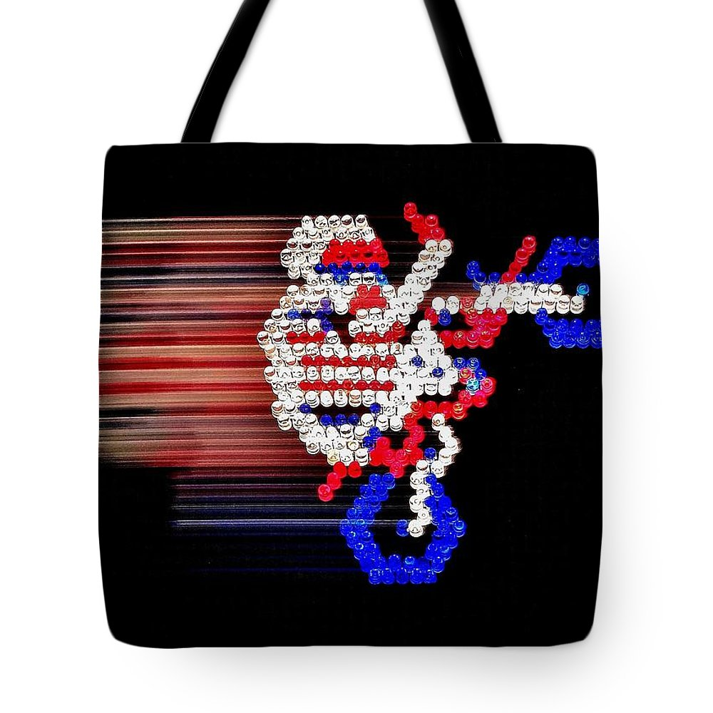 Nintendo Tote Bag featuring the photograph Excitebrite by Benjamin Yeager