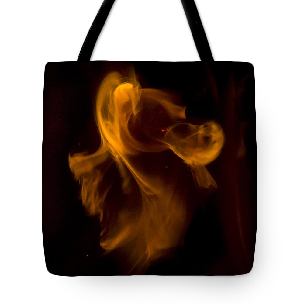Ignition Tote Bag featuring the photograph Exorcism by Steven Poulton