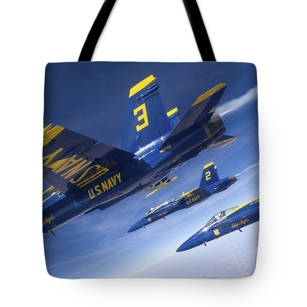 Military Tote Bag featuring the photograph Fa-18 Hornets Of The Blue Angels Fly by Stocktrek Images