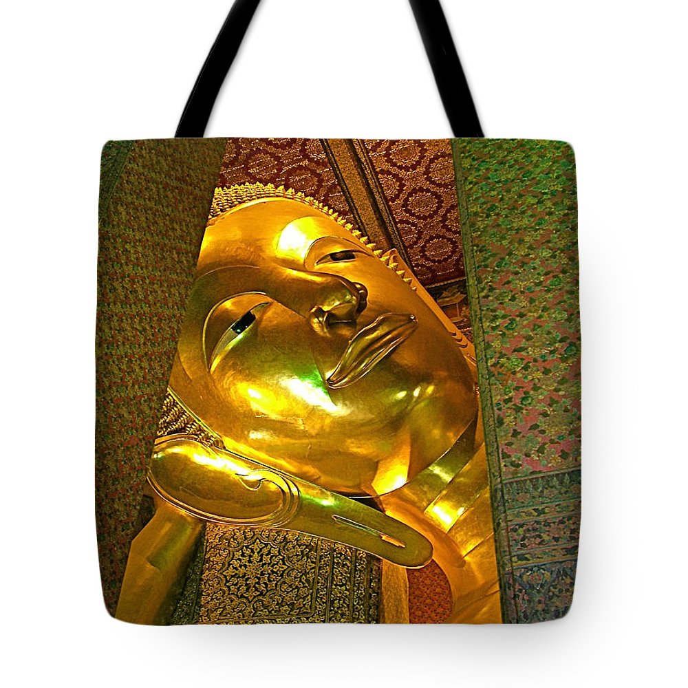 Face Of Reclining Buddha In Wat Po In Bangkok Tote Bag featuring the photograph Face Of Reclining Buddha In Wat Po In Bangkok-thailand by Ruth Hager