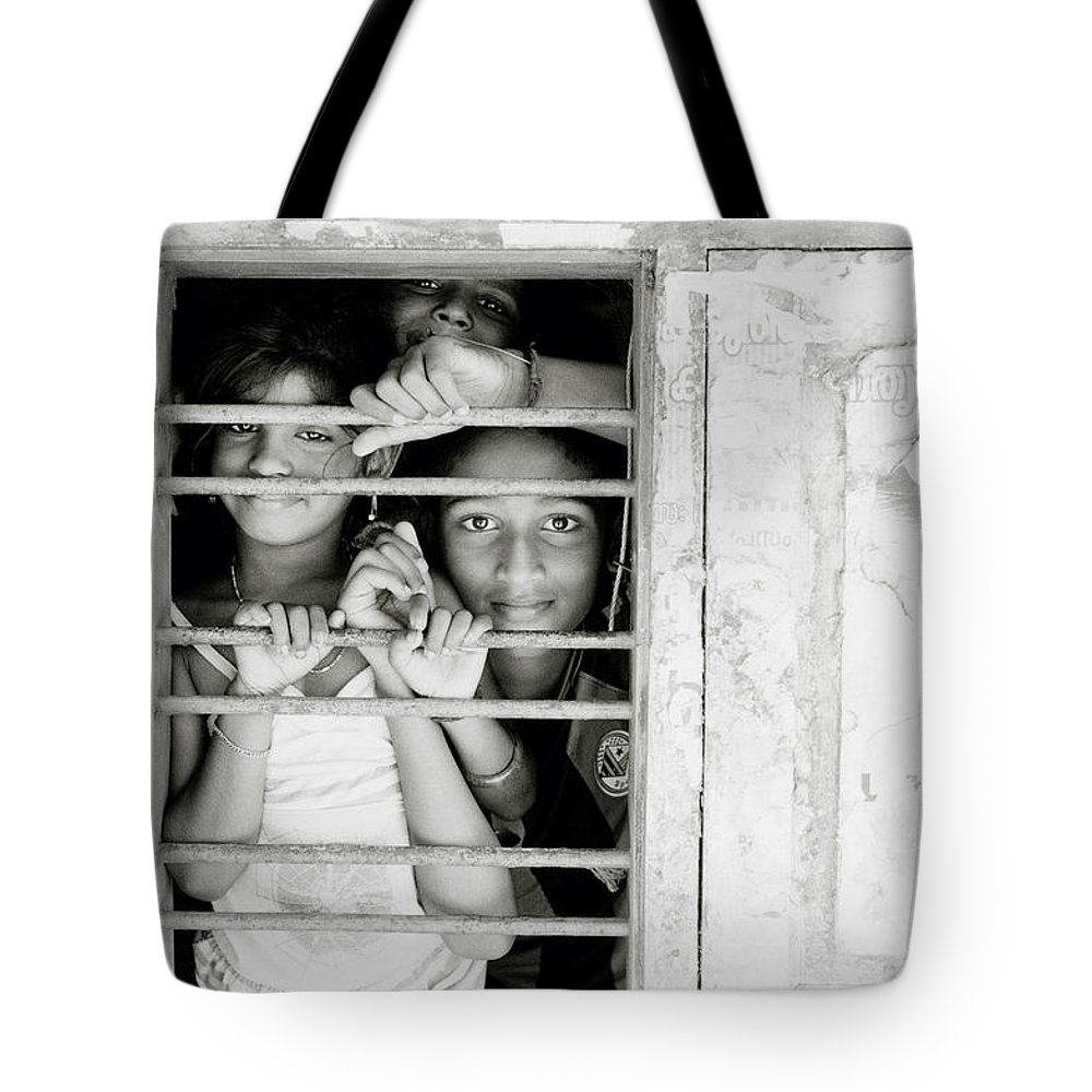 India Tote Bag featuring the photograph Faces At The Window by Shaun Higson