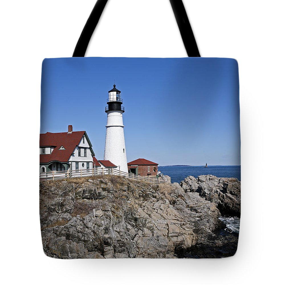 Portland Head Light Tote Bag featuring the photograph Fall At The Lighthouse by Eric Swan