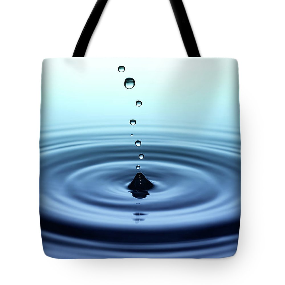Water Surface Tote Bag featuring the photograph Falling Small Drops Of Water by Trout55