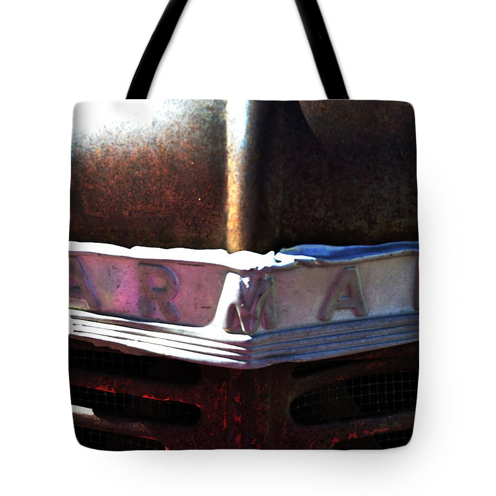 Tractor Tote Bag featuring the photograph Farmall Tractor by Pam Romjue