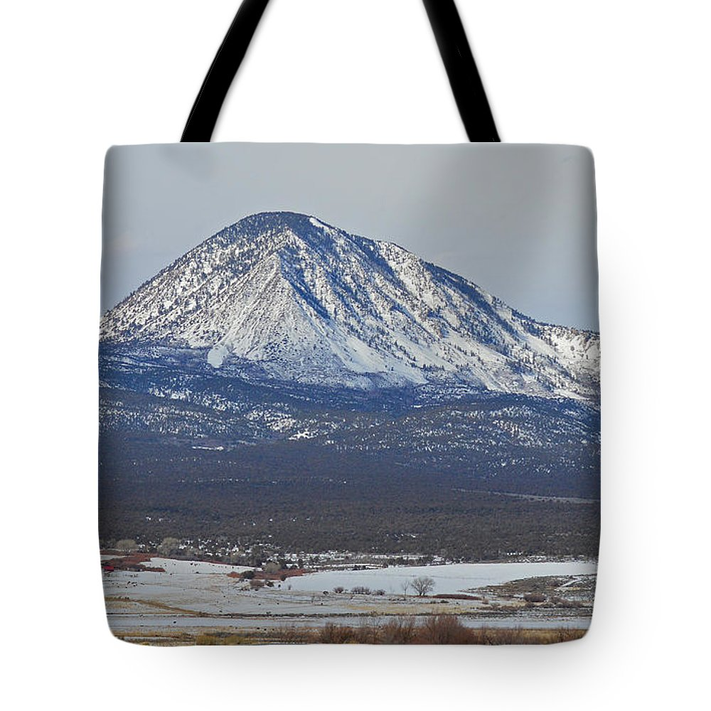 Colorado Tote Bag featuring the photograph Farmland Under The Mountain by Meandering Photography
