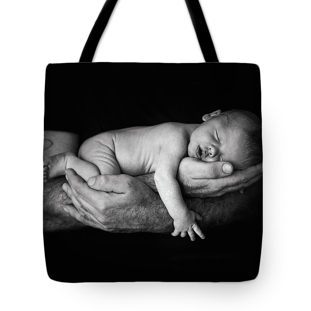 Human Arm Tote Bag featuring the photograph Father Holding Newborn Baby by Lise Gagne