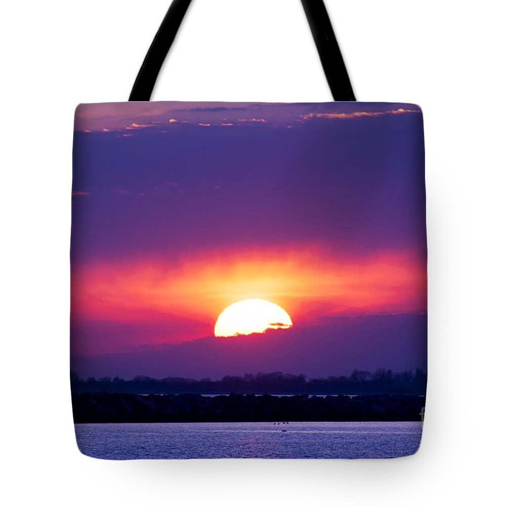 Sun Tote Bag featuring the photograph February Sunset by Joe Geraci