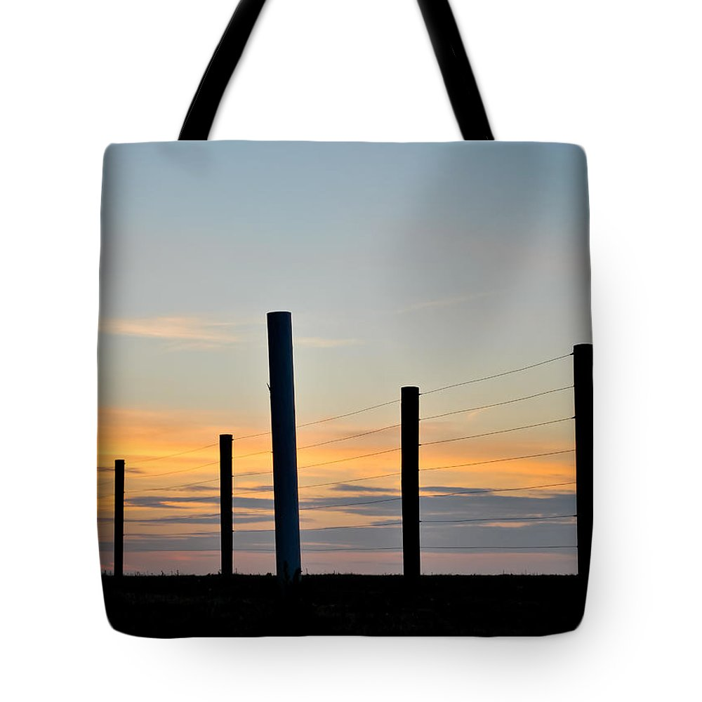 Fence Tote Bag featuring the photograph Fence Posts At Sunset by Wayne King
