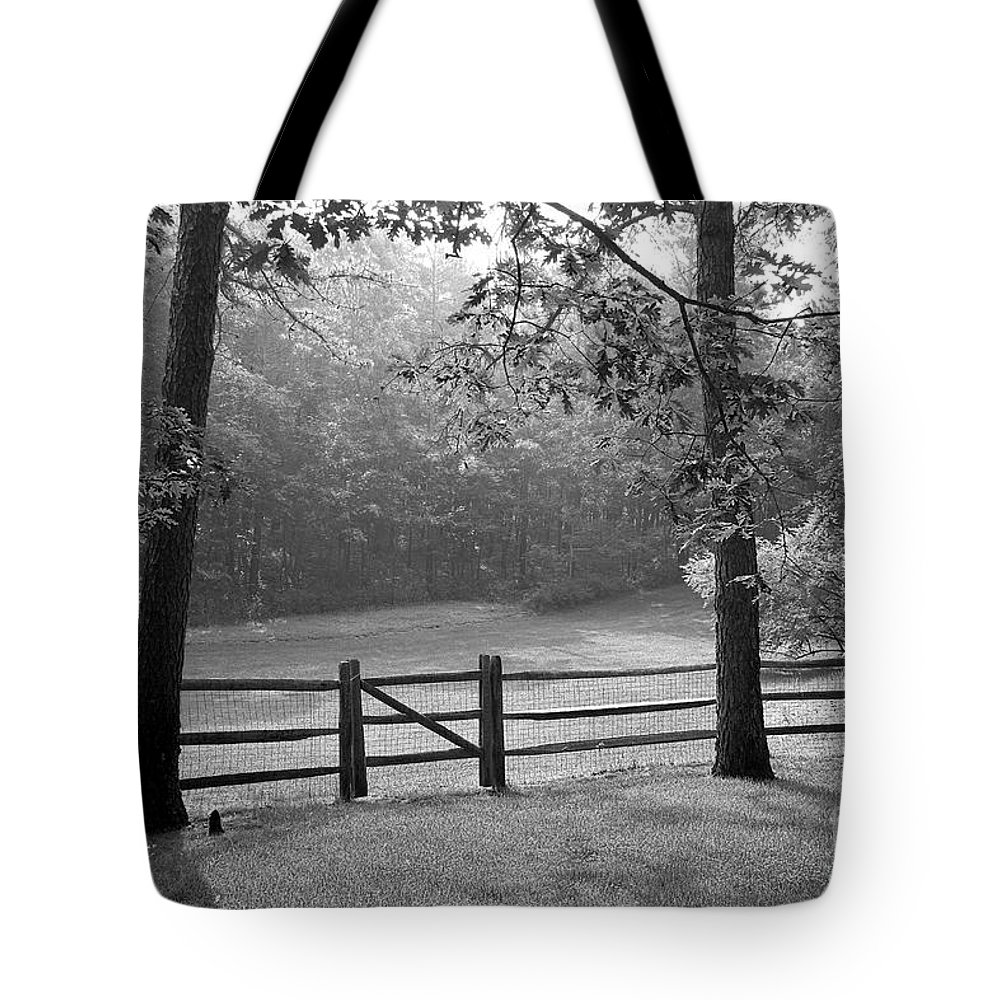 Black & White Tote Bag featuring the photograph Fence by Tony Cordoza