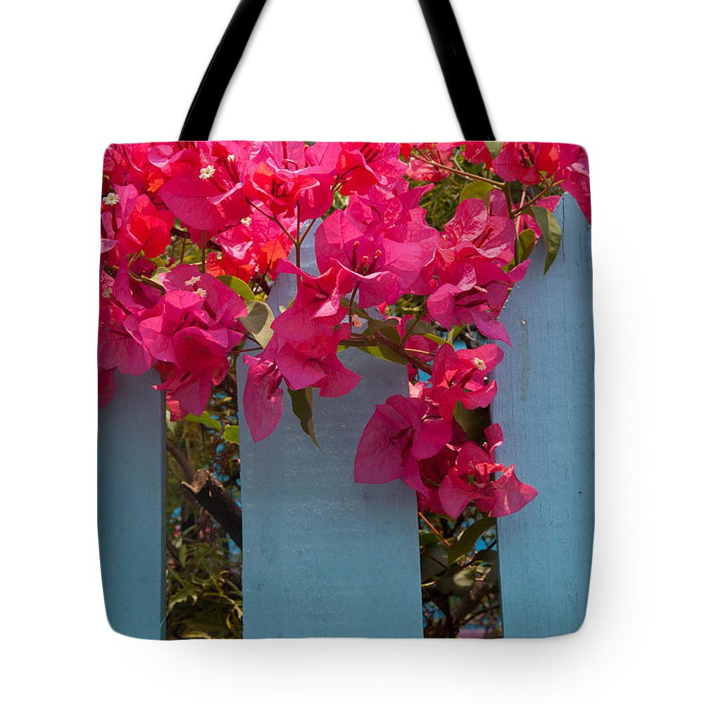 Roatan Tote Bag featuring the photograph Fence With Bouganvillia by Susan Rovira
