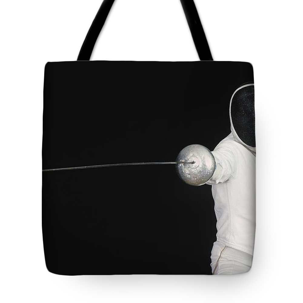 Fence Tote Bag featuring the photograph Fencer by Bilderbuch