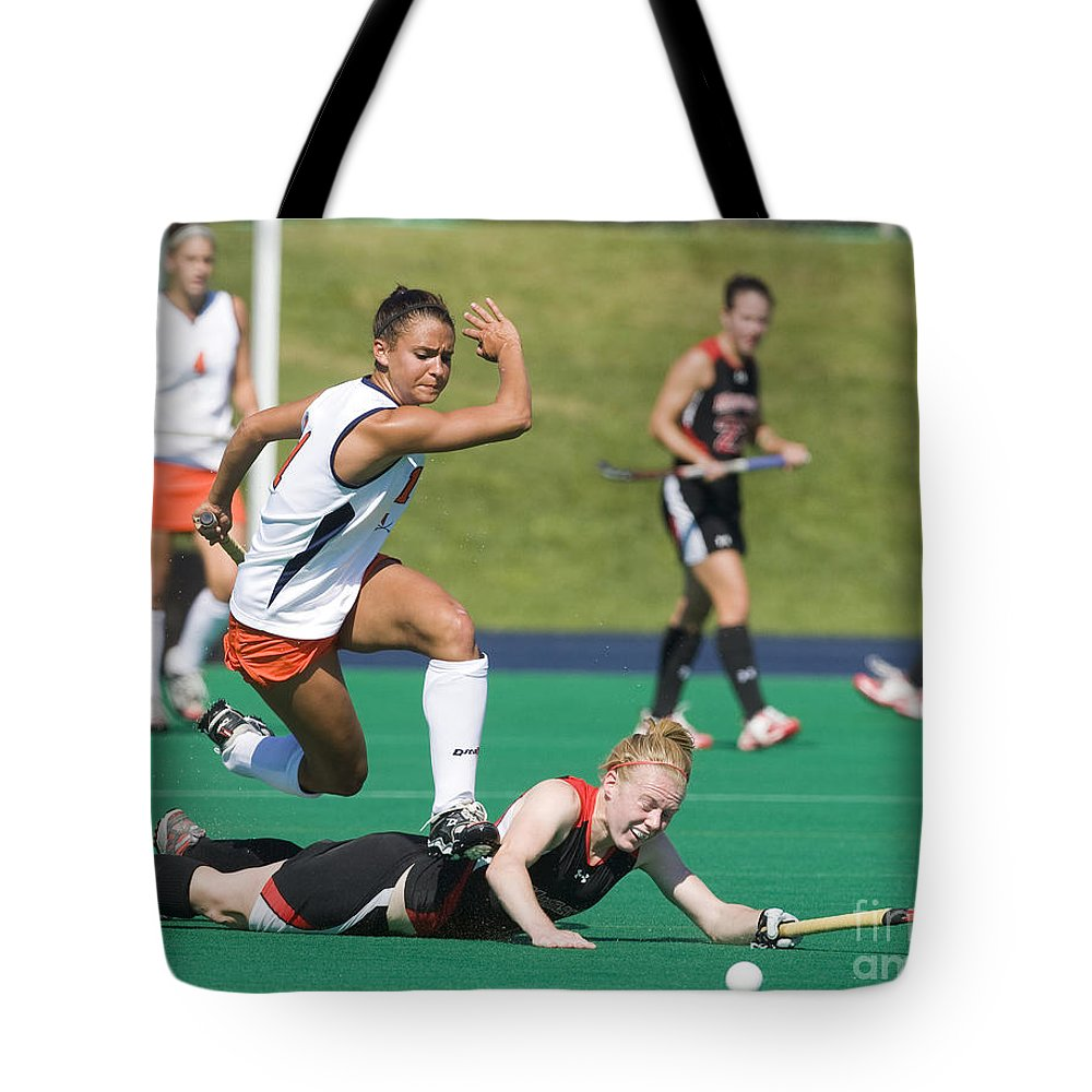University Of Virginia Tote Bag featuring the photograph Field Hockey Hurdle by Jason O Watson
