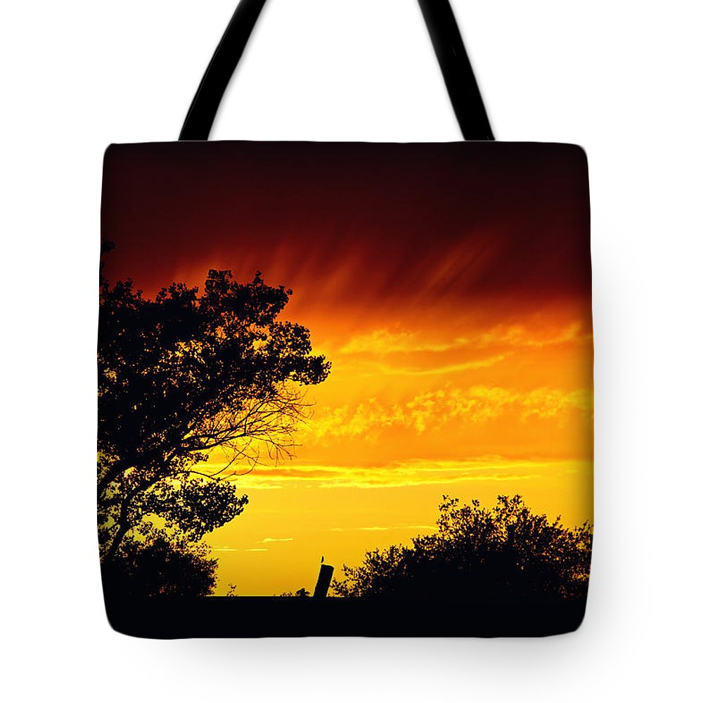Sunset Tote Bag featuring the photograph Fiery Sunset by Shawn McMillan