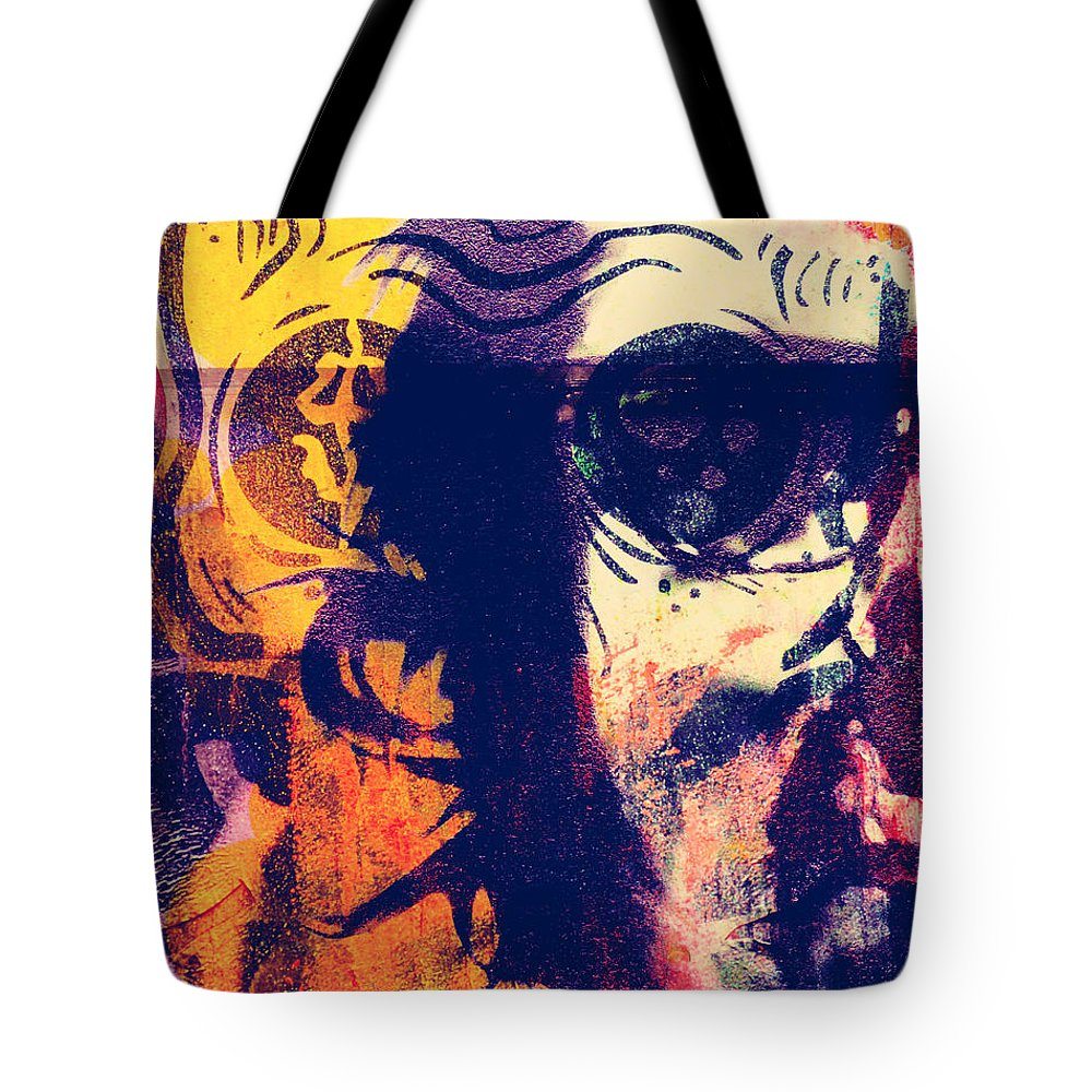 Faces Tote Bag featuring the photograph Fight The Demons by The Artist Project