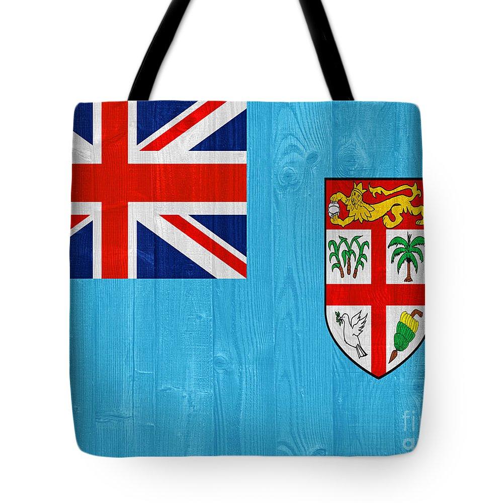 Fiji Tote Bag featuring the photograph Fiji Flag by Luis Alvarenga